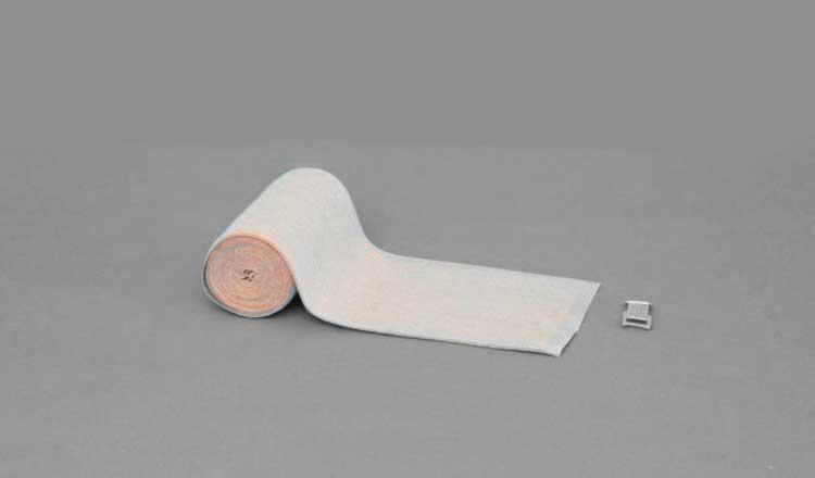 Banda elastica compressiva a corta elasticità